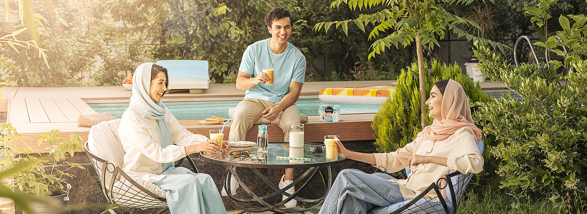 Friends drinking Nescafe Ice together by the pool - emotional marketing